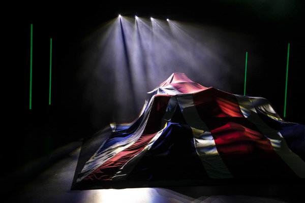 The Union Jack draped across the Aston Martin AMR21