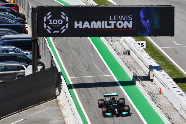 Sir Lewis Hamilton, Mercedes W12, drives into Parc Ferme after securing his 100th pole position in F1