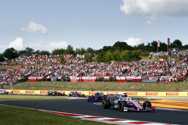 Sergio Perez, Racing Point RP19, leads Alexander Albon, Toro Rosso STR14, and Daniil Kvyat, Toro Rosso STR14