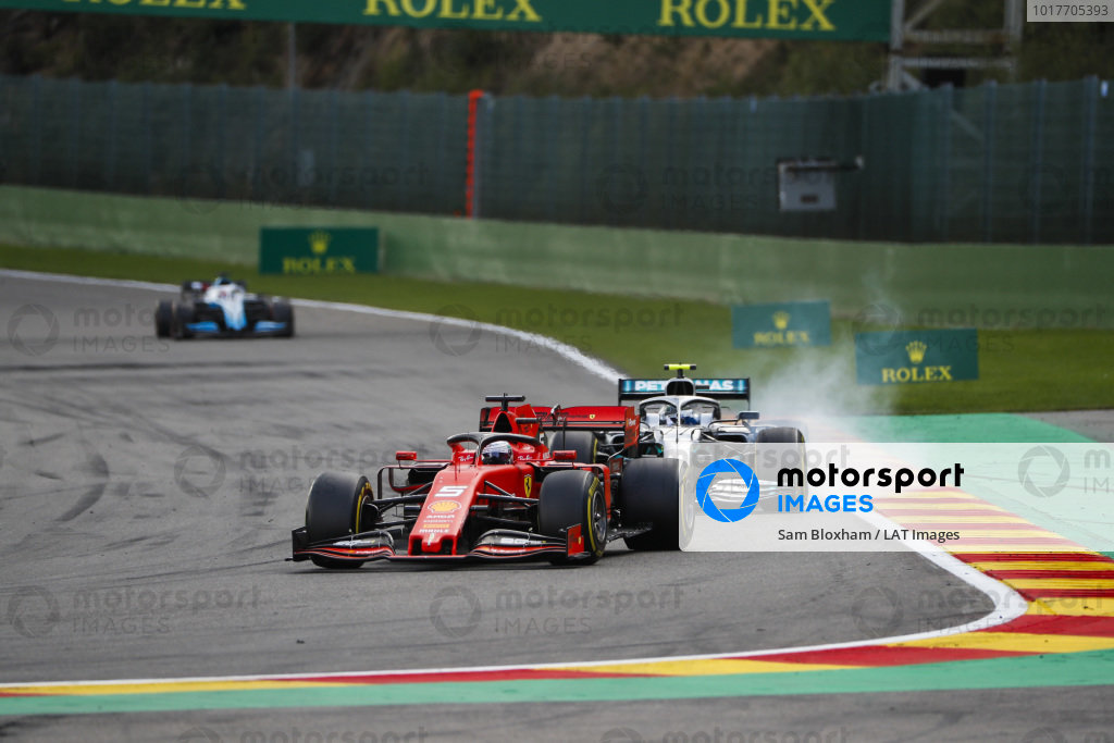 Sebastian Vettel, Ferrari SF90, leads Valtteri Bottas, Mercedes AMG W10, and George Russell, Williams Racing FW42