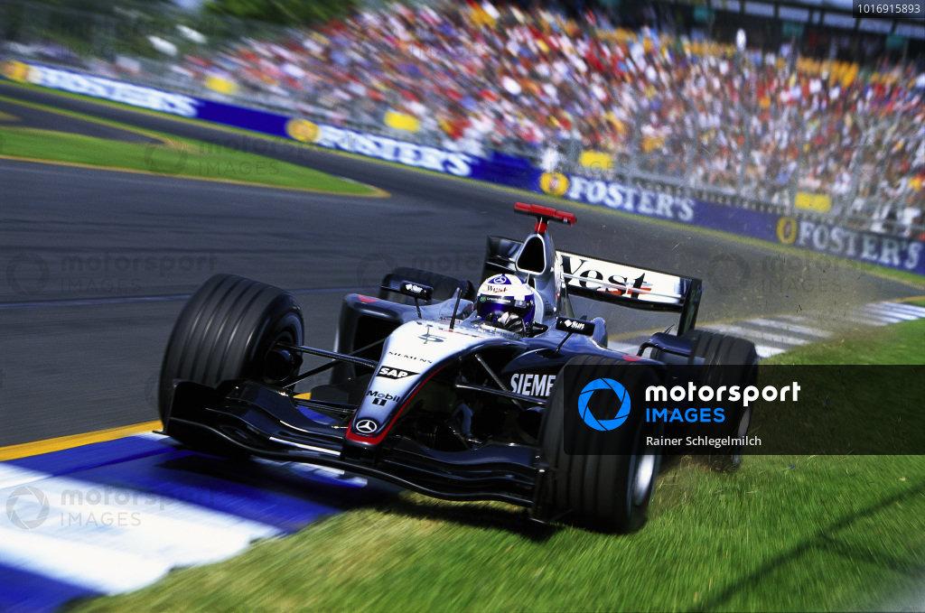 David Coulthard, McLaren MP4-19 Mercedes, runs wide at the final corner.