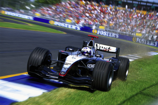 David Coulthard, McLaren MP4-19 Mercedes, runs wide at the final corner.