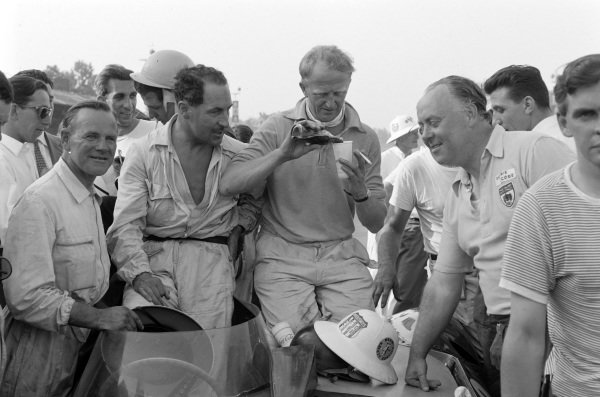 Ninian Sanderson, Jack Fairman and John Lawrence enjoy a drink with the Ecurie Ecosse team.