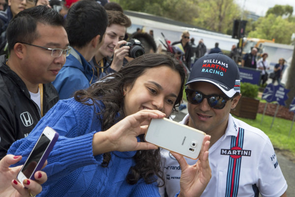 Felipe Massa (BRA) Williams poses for a selfie with the fans at Formula One World Championship, Rd1, Australian Grand Prix, Practice, Albert Park, Melbourne, Australia, Friday 18 March 2016.