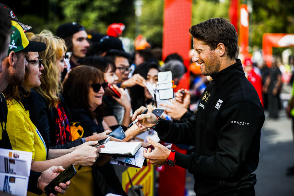Romain Grosjean, Haas F1 Team signs a autograph for a fan at the Federation Square event