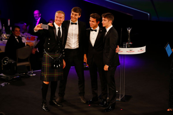 """2017 Autosport Awards Grosvenor House Hotel, Park Lane, London. Sunday 3 December 2017. David Coulthard takes a selfie with """"the future of Formula 1"""", George Russell, Lando Norris and Charles Leclerc. World Copyright: Zak Mauger/LAT Images Ref: Digital Image _l5r8114"""