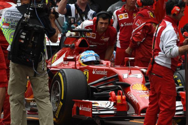 Fernando Alonso (ESP) Ferrari F14 T in his pit box. Formula One World Championship, Rd6, Monaco Grand Prix, Practice, Monte-Carlo, Monaco, Thursday 22 May 2014.