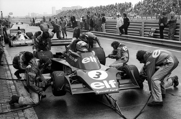 Jody Scheckter (RSA) Tyrrell 007 makes a pit stop to change to slick tyres in the drying conditions. He finished sixteenth and last after stopping with an engine problem.