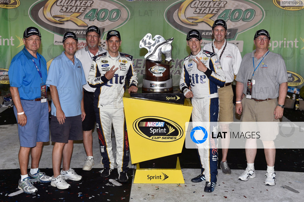 27-28 June, 2014, Sparta, Kentucky USA Brad Keselowski celebrates his win in Victory Lane with Ford guests ?2014, Nigel Kinrade LAT Photo USA