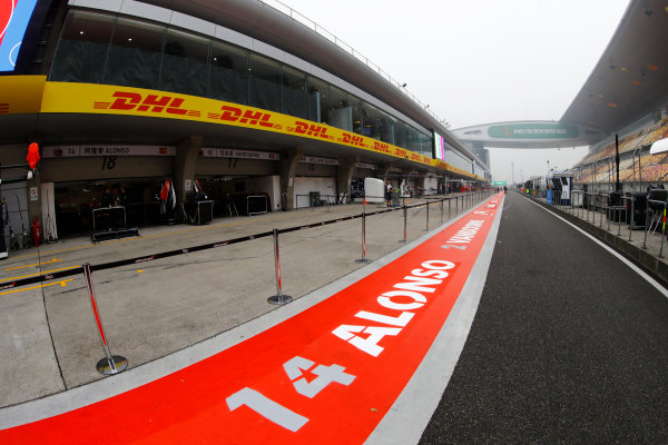 Shanghai International Circuit, Shanghai, China.  Thursday 06 April 2017. The pit lane in China, including Fernando Alonso branding outside of the McLaren garage. World Copyright: Steven Tee/LAT Images ref: Digital Image _R3I1307