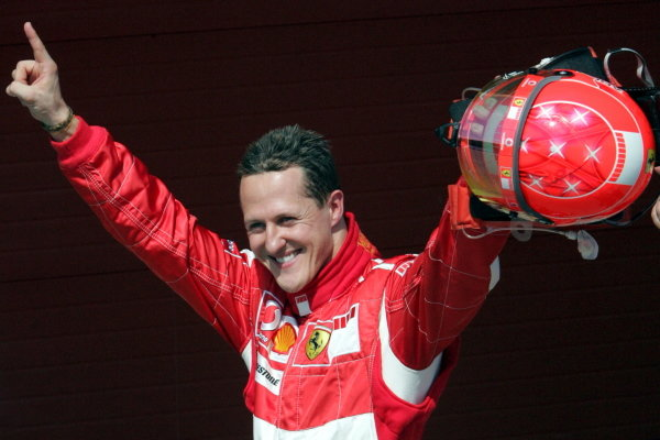 Michael Schumacher (GER) Ferrari celebrates taking pole position.