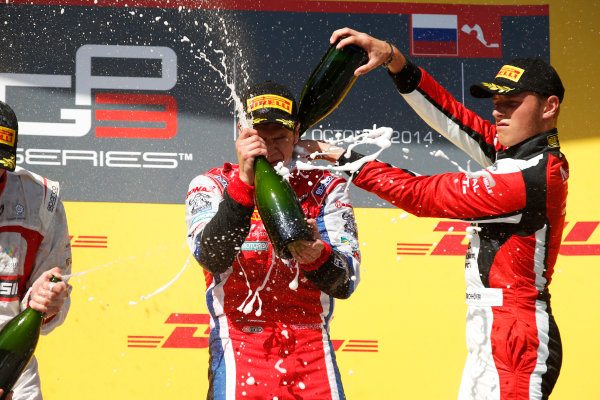 2014 GP3 Series. Round 8.   Sochi Autodrom, Sochi, Russia. Sunday Race 2 Sunday 12 October 2014. Dean Stoneman (GBR, Marussia Manor Racing), Patric Niederhauser (SUI, Arden International) amd Marvin Kirchhofer (GER, ART Grand Prix) spray the champagne on the podium. Photo: Glenn Dunbar/GP3 Series Media Service. ref: Digital Image _89P3025