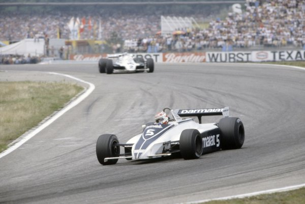 1981 German Grand Prix.Hockenheim, Germany. 31 July-2 August 1981.Nelson Piquet (Brabham BT49C-Ford Cosworth) leads Carlos Reutemann (Williams FW07C-Ford Cosworth). Piquet finished in 1st position.World Copyright: LAT PhotographicRef: 35mm transparency 81GER24