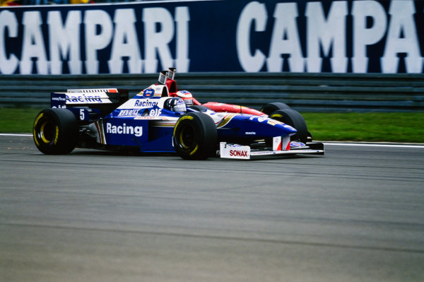 1996 European Grand Prix  Nurburgring, Germany. 26-28 April 1996.  Damon Hill, Williams FW18 Renault, battles with Michael Schumacher, Ferrari F310.  Ref: 96EUR15. World copyright: LAT Photographic
