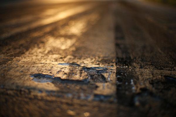 Hungaroring, Budapest, Hungary. Friday 24 July 2015. Track surface detail as the sun rises. World Copyright: Charles Coates/LAT Photographic ref: Digital Image _J5R4575