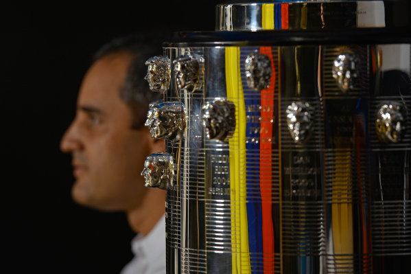 9 December, 2015, Indianapolis, Indiana USA 2015 Indianapolis 500 winner Juan Pablo Montoya in profile next to his likeness on the base of the Borg-Warner Trophy (bottom, front). ?2015, F. Peirce Williams LAT Photo USA
