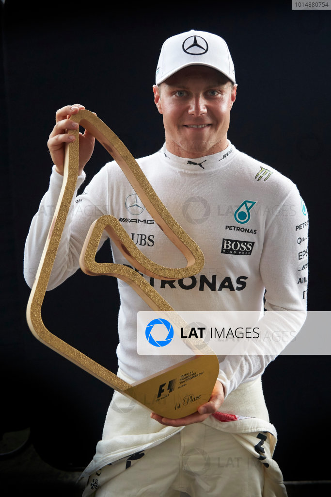 Red Bull Ring, Spielberg, Austria. Sunday 9 July 2017. Valtteri Bottas, Mercedes AMG, 1st Position, with his trophy. World Copyright: Steve Etherington/LAT Images ref: Digital Image SNE19030