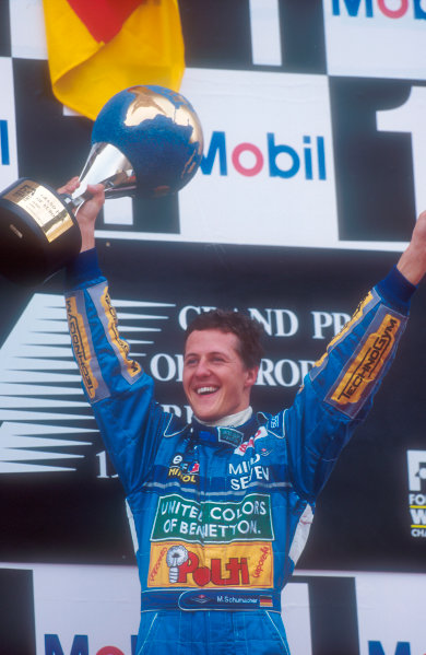 Jerez, Spain.14-16 October 1994.Michael Schumacher (Benetton Ford) celebratres 1st position on the podium.Ref-94 EUR 05.World Copyright - LAT Photographic
