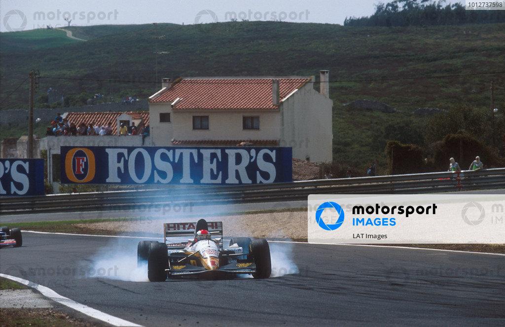 1994 Portuguese Grand Prix.Estoril, Portugal.23-25 September 1994.Johnny Herbert (Lotus 109 Mugen-Honda) 11th position, locking up. Ref-94 POR 02.World Copyright - LAT Photographic