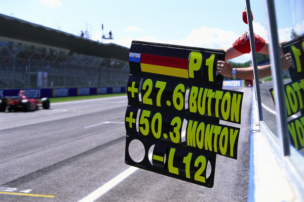 Michael Schumacher, Ferrari F2004, passing his pit board.