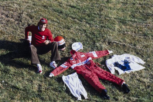 Niki Lauda displays his racing overalls and fireproofs.