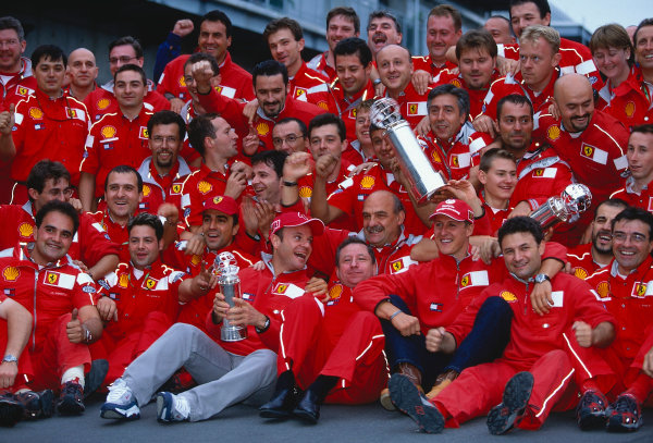2000 United States Grand Prix.Indianapolis, Indiana, USA. 22-24 September 2000.Michael Schumacher and Rubens Barrichello (Ferrari) celebrate their 1st and 2nd positions respectively with the Ferrari team.Ref-2K USA 02.World Copyright - LAT Photographic