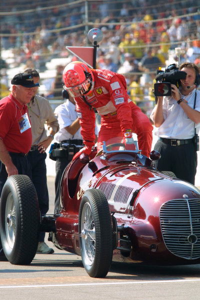 """2002 American Grand Prix.Indianapolis, Indiana, USA. 27-29 September 2002.Michael Schumacher (Ferrari) drives the 1940 Indy 500 winning Maserati Tipo 8CTF """"Boyle Special"""" on a demonstration run.World Copyright - LAT Photographicref: Digital File Only"""