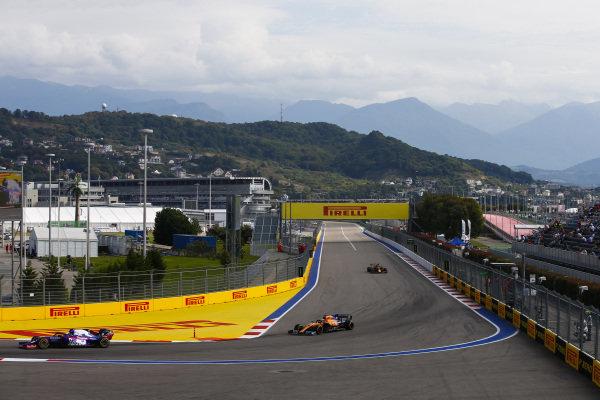 Pierre Gasly, Toro Rosso STR14, Carlos Sainz Jr., McLaren MCL34 and Alexander Albon, Red Bull RB15