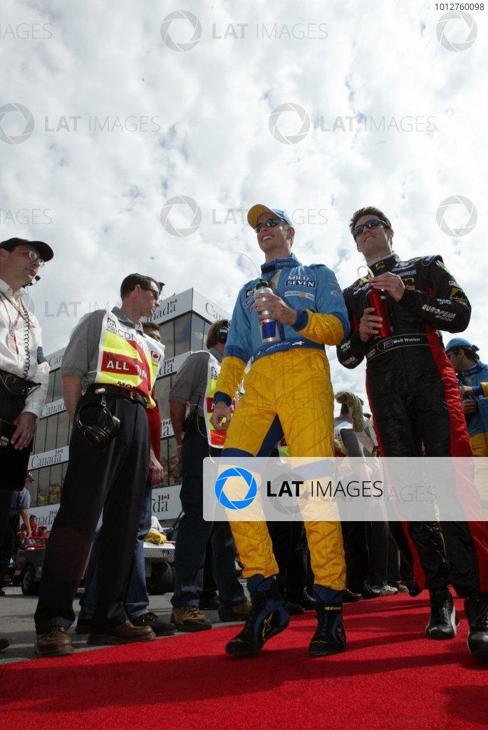 2002 Canadian Grand Prix - RaceMontreal, Canada. 9th June 2002Jenson Button (Renault) and Mark Webber (Minardi-Asiatech).World Copyright: Steve Etherington/LATref: Digital Image Only