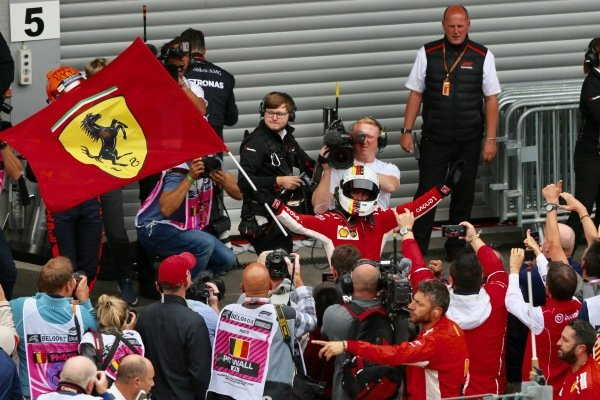 Sebastian Vettel, Ferrari celebrates with ferrari flag in parc ferme