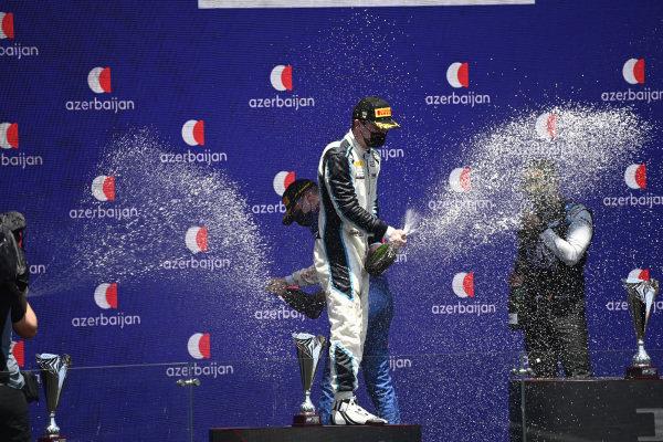 Dan Ticktum (GBR, Carlin), 2nd position, sprays Champagne