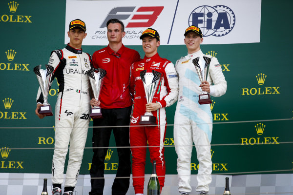 HUNGARORING, HUNGARY - AUGUST 04: Leonardo Pulcini (ITA) Hitech Grand Prix, Race winner Marcus Armstrong (NZL) PREMA Racing and Jake Hughes (GBR) HWA RACELAB on the podium with the trophy during the Hungaroring at Hungaroring on August 04, 2019 in Hungaroring, Hungary. (Photo by Joe Portlock / LAT Images / FIA F3 Championship)