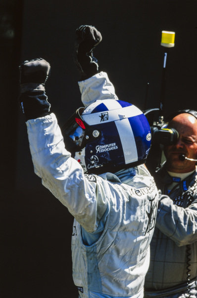 David Coulthard, 1st position, celebrates in Parc Ferme.