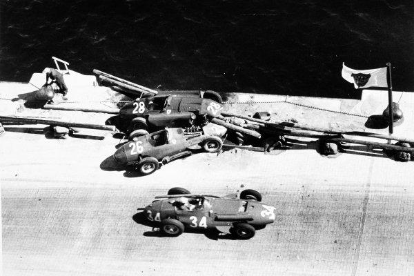 1957 Monaco Grand Prix Monte Carlo, Monaco. 19 May 1957 Giorgio Scarlatti, Maserati 250F, retired, passes the crashed cars of Peter Collins, Lancia-Ferrari D50, and Mike Hawthorn, Lancia-Ferrari D50, action, accident World Copyright: LAT PhotographicRef: Autosport b&w print