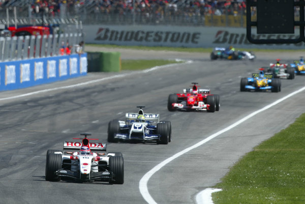 2004 San Marino Grand Prix-Sunday Race,Imola, Italy. 25 April 2004.Takuma Sato, in 4th place, leads Ralf Scumacher, Rubens Barrichello and a gaggle of mid field runners .World Copyright: LAT Photographic.Ref: Digital Image only.