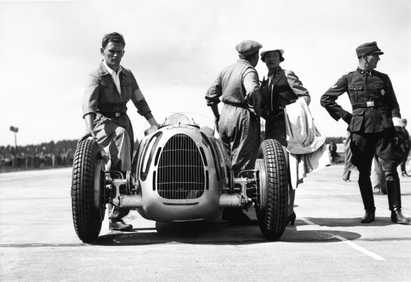 Nurburgring, Germany. 25 July 1937.  Hans Stuck, Auto Union C, retired, on the starting grid before the race.  Ref: RF37_GER_24. World Copyright: Robert Fellowes/LAT Photographic