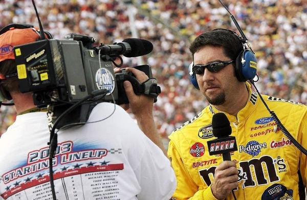 Fifth placed Elliott Sadler (USA) Robert Yates Racing M&M's Ford is interviewed prior to qualifying.