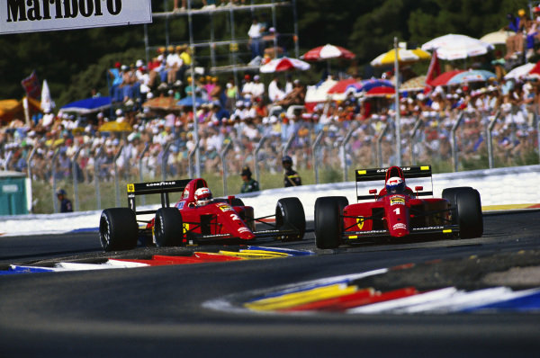 Alain Prost, Ferrari 641/2, leads team-mate Nigel Mansell.