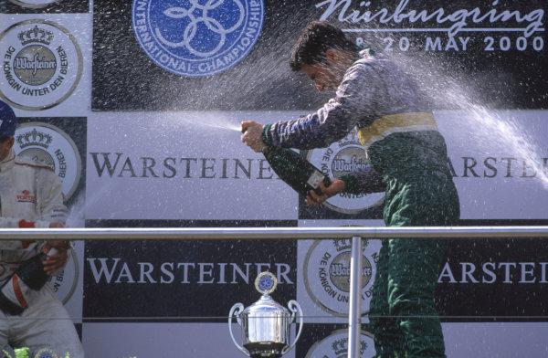 International Formula 3000 Championship Nurburgring, Germany. 19th - 20th May 2000 Race winner Bruno Junqueira ( Petrobras Jnr Team ), sprays the champagne World - Bellanca/LAT Photographic