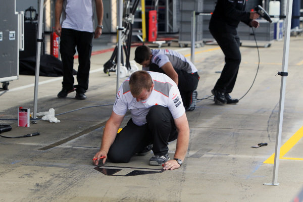 A McLaren mechanic prepares their pit stop area. Formula One World Championship, Rd9, British Grand Prix Wednesday Preparations, 4 July 2012.