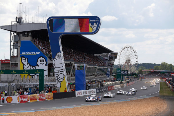 2014 Le Mans 24 Hours. Circuit de la Sarthe, Le Mans, France. Saturday 14 June 2014. Alexander Wurz (AUT), Stephane Sarrazin (FRA), Kazuki Nakajima (JPN) - Toyota Racing, Toyota TS 040 - Hybrid, leads Romain Dumas (FRA), Neel Jani (CHE), Marc Lieb (DEU) - Porsche Team, Porsche 919 - Hybrid  Photo: Sam Bloxham/LAT ref: Digital Image _SBL0725