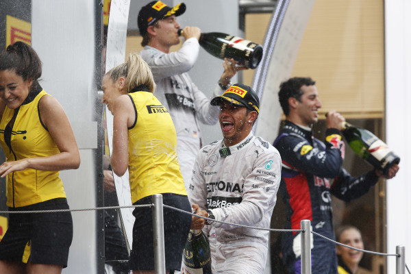 Circuit de Catalunya, Barcelona, Spain. Sunday 11 May 2014. Lewis Hamilton celebrates on the podium. World Copyright: Charles Coates/LAT Photographic. ref: Digital Image _J5R4433