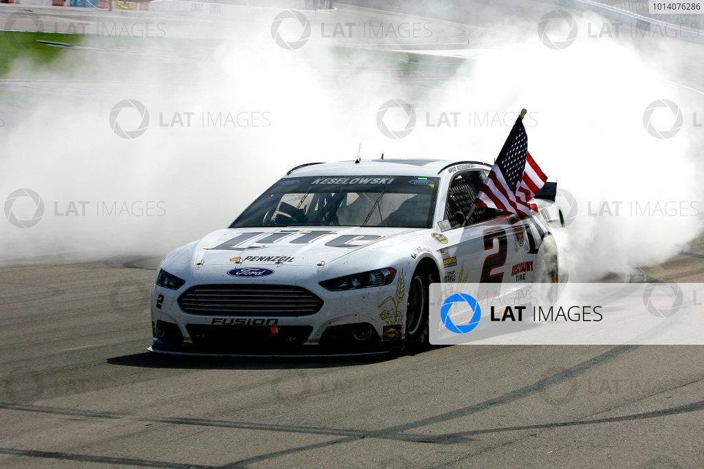 7-9 March, 2014, Las Vegas, Nevada USA Brad Keselowski celebrates his win with a burnout ©2014, Russell LaBounty LAT Photo USA