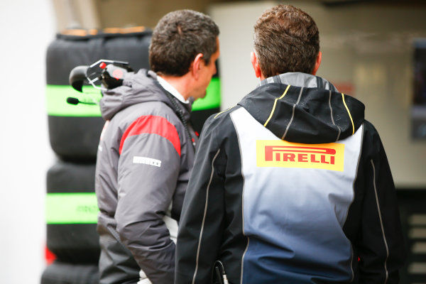 Shanghai International Circuit, Shanghai, China.  Friday 7 April 2017. Guenther Steiner, Team Principal, Haas F1, with Mario Isola, Racing Manager, Pirelli Motorsport. World Copyright: Andrew Hone/LAT Images ref: Digital Image _ONZ4186