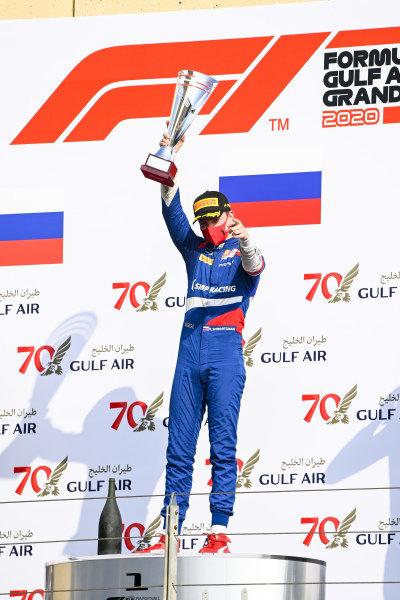 Race Winner Robert Shwartzman (RUS, PREMA RACING) celebrates on the podium with the champagne
