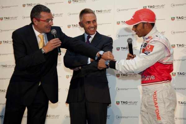 (L to R): Jean-Christophe Babin, CEO and President TAG Heuer, Martin Whitmarsh (GBR) and Lewis Hamilton (GBR) McLaren.