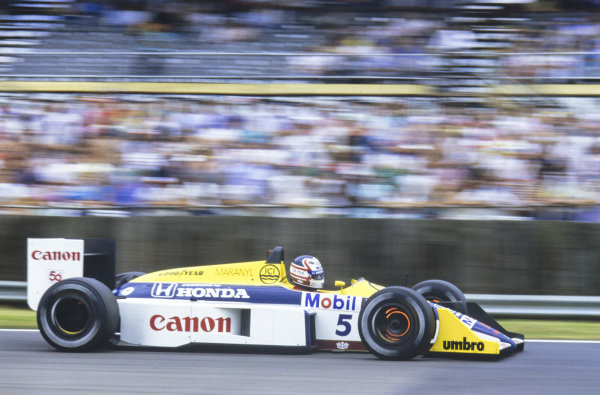 Nigel Mansell, Williams FW11B Honda, with glowing front brakes.
