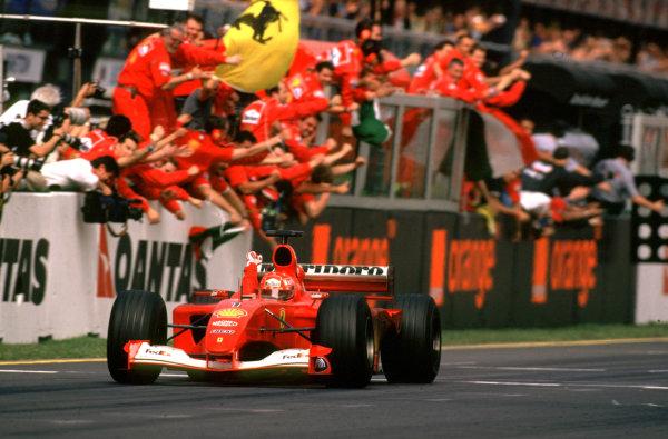 Australian Grand Prix. Albert Park, Melbourne, Australia.  2-4 March 2001. The Ferrari team cheer as Michael Schumacher takes 1st position. World Copyright - Steven Tee/LAT Photographic  ref: 35mm Image Aus A01