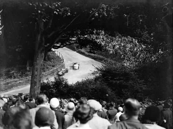 George Eyston leads Eddie Hall, both in MG Midgets, past spectators at Bottom Ess.