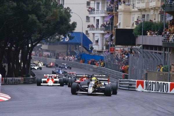 1985 Monaco Grand Prix.Monte Carlo, Monaco.15-19 May 1985.Ayrton Senna (Lotus 97T Renault) leads the field into Ste. Devote at the start.Ref-85 MON 01.World Copyright - LAT Photographic